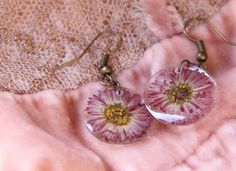 Earrings made of dried Marguerite flowers, protected with crystal resin. Earrings are some transparent. This is lightweight earrings. Earrings size is 2 cm (0.8 inch)  Thank you for visiting my shop. I am very glad to make beautiful jewelry for you. Ill be glad to see you at my other store. plush animals live there.  https://www.etsy.com/ru/shop/funnylittleanimals?ref=l..