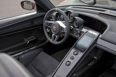 Porsche 918 Spyder interior.  Love this.  They should use this style of design for all their cars!