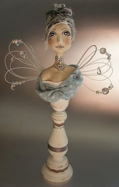 by Abi Monroe  Could do any mache bust on candle stick.