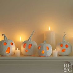 Make your mantle extra eerie with a collection of ghost pumkins and pillar candles. For extra impact, paint your pumpkins white before carving. Choose pumpkins that are similar in size and accent with assorted white pillar candles.