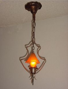 """A wonderful Arts & Crafts ceiling pendant, airy and light yet full of character. Hammered steel frame, hammered socket cover, and hammered cast iron ceiling canopy. Shown lit with an amber 40 watt light bulb which is included. The antique glass """"smoke bell"""" is original to these fixtures.  http://www.vintagelights.com/product/2/arts-crafts-craftsman-bungalow-style-vintage-smoke-bell-pendant.html"""