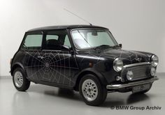 This is a Julie car. /// Kate Moss designed her own spider-web inspired Classic Mini in 1998.