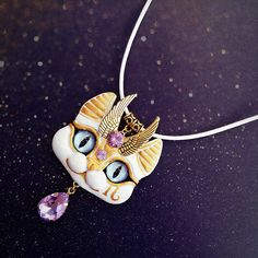 Hello! Remember this guy from my story? Just a white Sphinx with Purple/Amethyst gems, made to order  I really love using new gems and charms, new base used here as well - white faux leather cord  Hope you like him as much as I do  #sphinxcat #catartist #catart #egyptiancat #catpendant