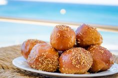 "Today we treat you with ""Koubanakia""! This delicious pastry, can only be found in the Eastern #Crete and everywhere in Ierapetra, in pastry shops. Sometimes these are also called ""Loukoumades"". Koubanakia are more like a healthy Cretan version of the Donut, deep fried in olive oil and dipped into local thyme honey syrup.  Κουνουμπάκια , παραδοσιακό κρητικό έδεσμα!     (CC-BY-SA 3.0) Crete Holiday, Eat Greek, Honey Syrup, Greek Cooking, Grilled Peaches, Pastry Shop, Greek Recipes, International Recipes, Greece"