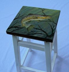 Brown trout hand painted on white bar stool I like the idea of placing a square wood top on stool and painting it.