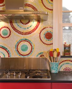 Love this cheerful mosaic backsplash. Via Ventana Construction