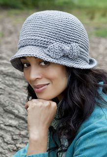 From the website: Get ready for fall with this sweet brimmed cloche from designer Kim Guzman. Kim chose the muted Grey Heather in Simply Soft for her crocheted creation, but this design would look equally lovely in any color—from Autumn Red to Chocolate. The sassy bow adds just the right touch of elegance and sophistication.