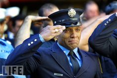 "On 9/11, the New York City Police Department lost 23 officers. The Port Authority police lost 37. The FDNY's dead numbered 343. Here, firefighter Tony James cries while attending the funeral service for New York Fire Department. September 15, 2001. ""Anytime you see a fireman or a symbol of strength breaking down like that, it resonates."""