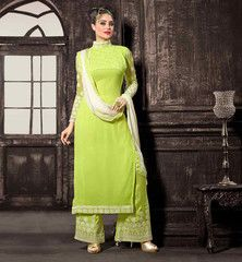 GREEN #SALWAR #KAMIZ WITH OFF WHITE DUPATTA. STRAIGHT CUT SALWAR DESIGN LOOKS DISTINGUISHED WITH CHINESE COLLAR AND UNIQUE DESIGN ON SLEEVES OF KAMEEZ PARTY WEAR DRESS ADORNED ZARI, RESHAM EMBROIDERY AND LACE ON BORDER