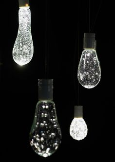 """water balloon"" is the product of a collaboration with a glass artist and each light bulb is made by hand using glass recycled from fluorescent lamps."