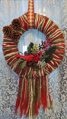 """this one is mine...I made it using a styrofoam ring, some yarn and some Christmas picks from the craft store...use a length of ribbon to hang it with a wire ornament hanger and """"voila!"""""""