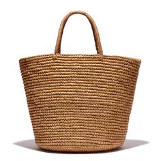 Handmade by Ecuadorian artisans using nothing but ultra sturdy Toquilla straw, this neutral tote by Sensi Studio is extra roomy.
