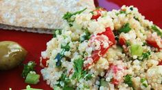 Quinoa, once a staple grain of ancient Incas, is tossed with lemon juice, tomatoes, cucumber, carrots, green onions and parsley. Serve with pita bread.
