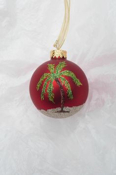 Items similar to Palm Tree Beach Glitter Ornament - Personalized Beach and Palm Tree Vacation Memory - Unique Red Glass Ornament on Etsy Christmas Palm Tree, Coastal Christmas Decor, Tropical Christmas, Beach Christmas, Christmas Balls, Christmas Tree Ornaments, Christmas Crafts, Christmas Decorations, Christmas Ideas