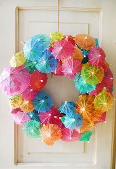 Drink Umbrella Wreath Here is a great fun idea for a summer wreath for your front door. Get a Styrofoam wreath and stick a ton of fun drink umbrellas in them. This would be so great to put out while hosting a luau or summer swim party! Umbrella Wreath, Mini Umbrella, Beach Umbrella, Umbrella Decorations, Christmas In July Decorations, Hawaiian Party Decorations, Christmas Wreaths, Christmas Crafts, Beach Party Themes