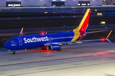 Southwest Boeing 737-8H4 jet airliner taxiing at night in Columbus