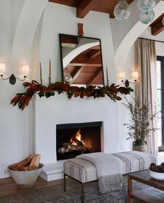 Retro Home Decor Cozy Fireplace + Fireplace Greenery + Amber + Plaster Fireplace + Wall Sconces + Fireplace mirror + living room + bench + Holiday decor Living Room Bench, Living Room Mirrors, Living Room Decor, Living Rooms, Living Spaces, Fireplace Mirror, Cozy Fireplace, Stucco Fireplace, Fireplace Remodel