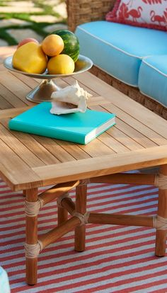 The geometric base of our Sanibel Coffee Table complements the woven wicker design of the coordinating seating. Crafted of teak, the tabletop will acquire a rich patina over time.    Frontgate: Live Beautifully Outdoors