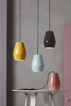 The Bell series by Northern Lighting consists of shiny porcelain pendant lights.
