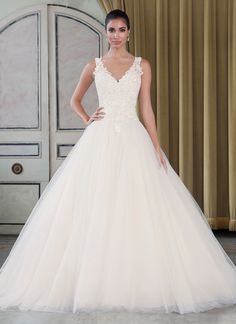 Beaded Venice lace and tulle ball gown with a v-neck neckline. https://www.justinalexanderbridal.com/signature_wedding_dresses/9793