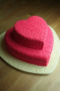 Wedding cake - simple colour with pretty heart shapes all over
