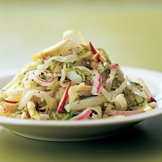 A crunchy slaw unites three suppliers of vitamin C: green cabbage, brussels sprouts, and citrus.