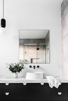 10 inspiring black and white bathrooms with incredible design and styling. From tile trends to statement lighting, we've compiled a gallery of the most incredible monochrome bathrooms.