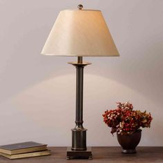 The classic columnar shape of this elegant table lamp makes this a versatile piece that pairs well with traditional and modern decor. The sturdy metal base has a warm antiqued bronze finish and is accented by an ivory fabric lampshade. Bedroom End Tables, Decor, Elegant Table Lamp, Mini Table Lamps, Small Table Lamp, Table Lamp, Small Tables, Light Fixtures, Traditional Table Lamps