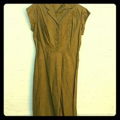Vintage 1950s Olive Day Dress Fab 1950s olive green day dress with metallic thread pinstriping. Buttons at the front. Zips at the side. Matching belt. Probably homemade. Feels like a stiff cotton. Measures about 16 inches flat across waist, approximately a modern size 8 to 10. Great vintage condition. Needs a pressing. Disclosure: I love this dress and would keep it, but the fabric is itchy on me. Should go to someone with less skin sensitivity. Vintage Dresses