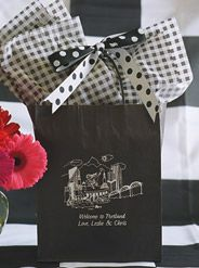 Portland Oregon is the destination for this #personalizedweddingwelcomebag. You can't go wrong with a black & white theme for #weddinggoodiebags for your #outoftownweddingguests. White ink is so striking on a black bag. The black & white #checkedtissuepaper is a great complement to the black & white reversible #dotribbon, so easy to tie. It all looks so tailored & well-planned. Your guests will really appreciate your thoughtfulness. www.FavorsYouKeep.com -512.323.0600 #PortlandWeddingIdeas