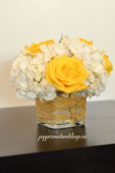 Bright yellow and white wedding flowers! Short centerpiece with white hydrangeas and yellow roses.