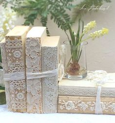 Lace covered old books for display