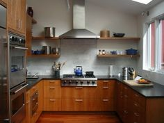 solid cherry cabinets, marble subway tile backsplash, stainless steel appliances contemporary kitchen