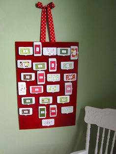 advent calendar...cute idea for reusing all the diaper wipe lids we will soon accumulate!