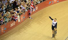 Team GB's Sir Chris Hoy celebrates after winning the men's team sprint gold