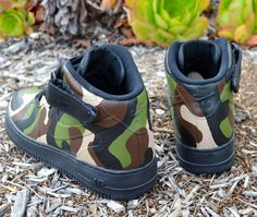 These Nike Air Force 1 Mids have a hand painted camo print all over. The paint is 100% permanent and will never come off. This order is customizable as I can paint this one-of-a-kind, original design