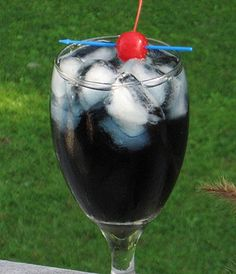 Purple Nurple  (2 oz. Malibu Rum  1 oz. Blue Curacao  1 oz. Triple Sec  3 oz. Cranberry Juice  Cherry for garnish)