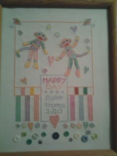 Sock monkey birth announcement 11X14. Made for a family friend. Colors are greens, pinks, yellows, blues and golds.  Stitched on 14 count Aida with DMC floss.