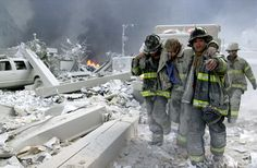 9/11 picture: firefighters helping an injured colleague