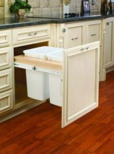 Functional #kitchen organization; hiding the trash cans.