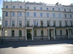 In QVT, this is No. 22 Belgrave Square, called Durham House. It is the residence of the Queen's Secretary, who is head of her secret intelligence service.    In our earthly timeline this was the residence of the Viscount Boyne in 1871, and is presently the site of the German Embassy in London.