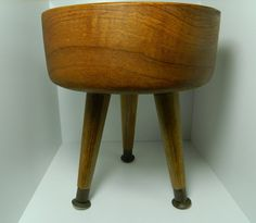 add legs to a wooden bowl to make a mid-century-style planter