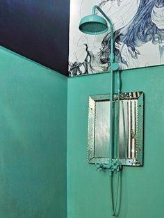Green shower in the spectacular Parisian apartment of Jean-Christophe Aumas, set designer.
