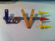 LOVE  Made from pieces  Finger nail clipper  Washer  Clothes pin Golf Tee's