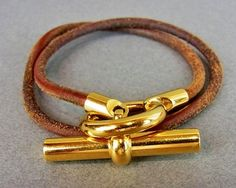 TOGGLE GOLD TONE CLASP BROWN LEATHER DOUBLE WRAP BRACELET CHOKER. Get the lowest price on TOGGLE GOLD TONE CLASP BROWN LEATHER DOUBLE WRAP BRACELET CHOKER and other fabulous designer clothing and accessories! Shop Tradesy now