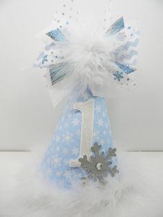 Personalized Blue Snowflake Birthday Party Hat by DoodlesDotsnDimples Birthday Party Hats, Snowflakes, Trending Outfits, Unique Jewelry, Handmade Gifts, Blue, Etsy, Kid Craft Gifts, Snow Flakes