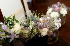 Bridal bouquets of lilac and white roses, astrantia, waxflower, erynginum, astilbe and freesia