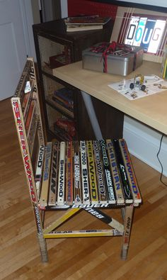Hockey stick chair. Might do this with ringette sticks :p