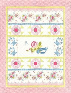 "R is for Rose quilt pattern by Elizabeth Scott for Late Bloomer Quilts.  ""Pick a favorite vintage-inspired rose print, add some simple pieced blocks, a beribboned rose spray, and a touch of embroidery to make this charming quilt. The applique is made easy with fusible web and machine blanket stitching"" says Elizabeth.  Finished Quilt measures 44"" x 56"""
