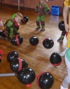 Easy simple party game for young kids. Blow up black balloons (can be done Night before the party) and stick red crepe paper on them to make them look like the foot soldiers, put pieces of paper with 'winner' in some of the balloons before you blow them up. At the party Tell the kids the foot soldiers have invaded and that they have to defeat them by bursting the balloons (sitting on them is easiest way) and if they find the paper they win a prize!